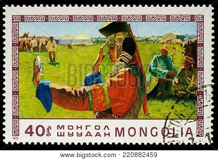 Moscow, Russia - January 06, 2018: A stamp printed in Mongolia, shows woman with mirror in Mongolian nomad camp, series