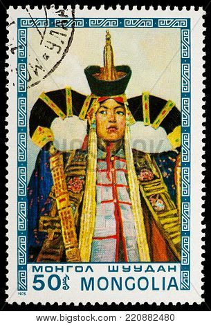 Moscow, Russia - January 06, 2018: A stamp printed in Mongolia, shows Mongolian woman in traditional costume, fixed garment, series
