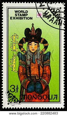 Moscow, Russia - January 07, 2018: A stamp printed in Mongolia, shows woman in Mongolian national costume, series