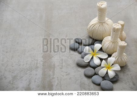 Frangipani with gray stones and, herbal ball.on gray background