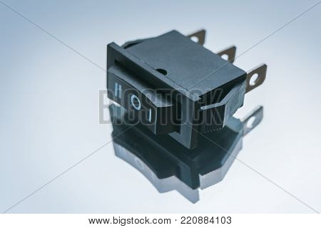 switch on off button on white background. principle of operation of single key light switches