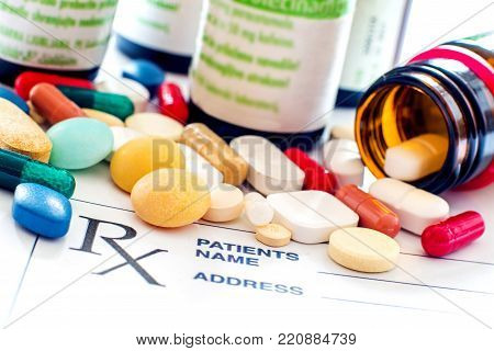 Close up photo of prescription pills with prescription paper
