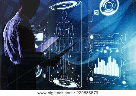 Businessman With Healthcare Screen