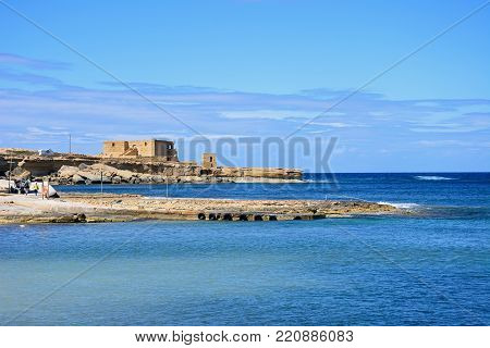 MARSALFORN, GOZO, MALTA - APRIL 3, 2017 - View along the rugged coastline towards the Il-Qolla I-Badja battery, Redoubt, Marsalforn, Gozo, Malta, Europe, April 3, 2017.