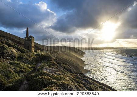 Cornish tin min engine house at Wheal Coates on cornwalls North coast at sunset with cloudy sky