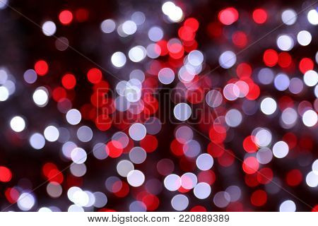 Bright unfocused color lights in evening, holiday background
