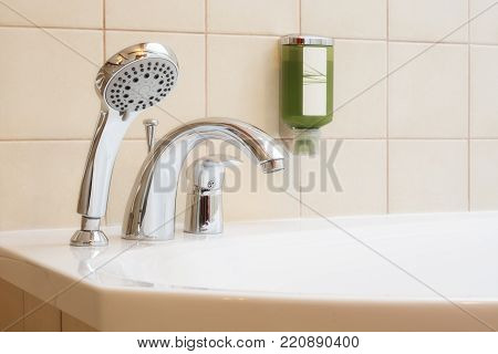 Shower and bath mixers in a bathroom.
