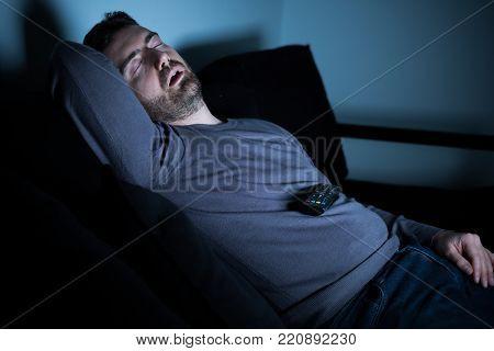 Bored Man Sleeping And Watching Tv At Night