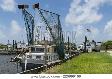 Lake Charles, Louisiana- June 15, 2014: Old shrimp trawler in a port in the banks of Lake Charles in the State of Louisiana, USA