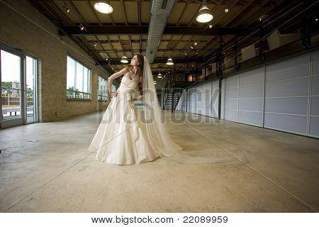 Bride Posing in a Warehouse