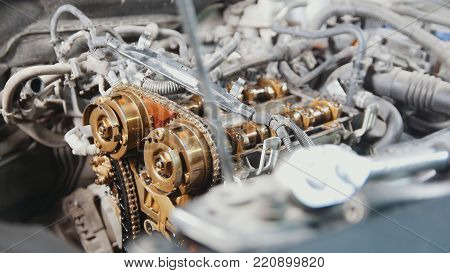 The internal combustion engine, disassembled, repair at car service, overhaul, under the hood of the car, close-up