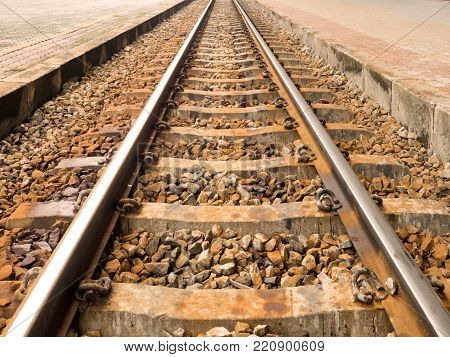 Metal railroad or railway train with rock. Concept of transportation, travel, target, success.