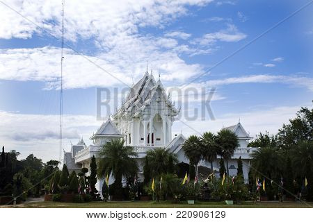 White ubosot of Wat Tham Khuha Sawan Temple Amphoe Khong Chiam, Ubon Ratchathani, Thailand for people visit and respect praying Buddha statue