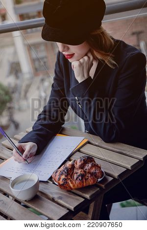 Portrait Of Young Businesswoman Sitting Near A Table