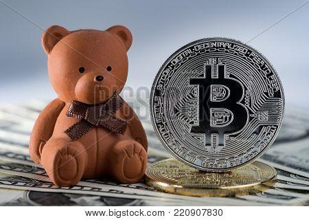 Bear doll with bitcoin crypto coin using as Bitcoin bear market trading.