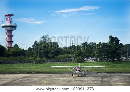 Air Traffic Control tower and Small plane stop on runway at Ubon Ratchathani International Airport on September 17, 2017 in Ubon Ratchathani, Thailand