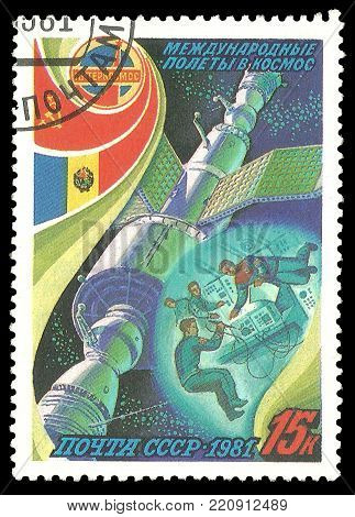 USSR - circa 1981: Stamp printed by USSR, Color edition on Soviet-Romanian Space Flight, shows Astronauts conducting research in orbit, circa 1981