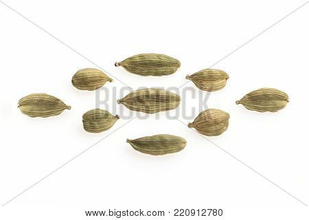Cardamom seeds on rhombus on white background