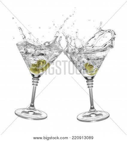 glasses of martini with olives toasting creating splashes isolated on white background. Splash of martini. Pair of martini glasses making toast. Cheers