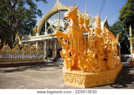 Candle figure in the parade of traditional parading Ubon Ratchathani Candle Festival for show people and travelers looking and visit at Wat Phra That Nong Bua Temple in Ubon Ratchathani, Thailand