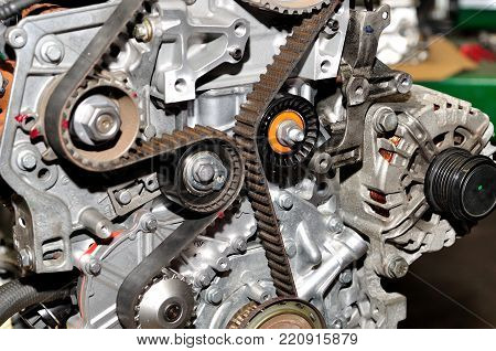 Car engine with timing belt and multiple drive wheels..