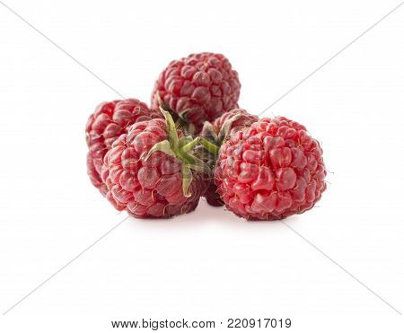 Raspberries isolated on white. Raspberry close-up. Vegetarian or healthy eating. Juicy and delicious raspberries on a white background.