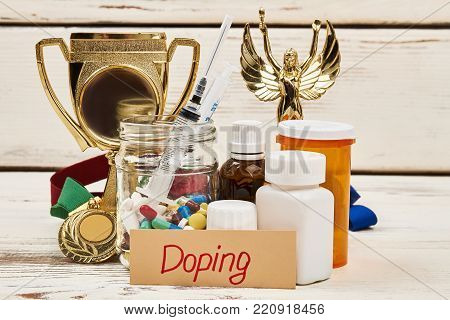 Doping medications and trophy. Drugs to enhance athletic performance. Unfair victory and crime in sports. poster