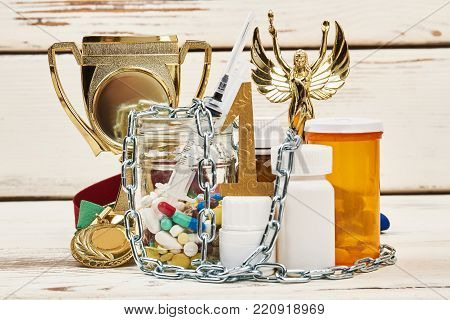 Victory and prohibited medications. Recreational and enhancing performance drugs. Violation of sport ethics, crime and deception.