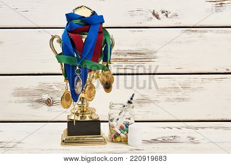 Awards and banned medications. Drugs and injections to enhance performance. Deceptive way to reach the first place.