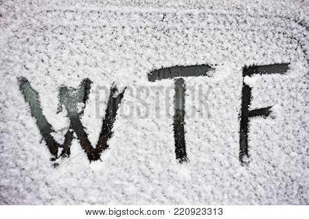 WTF inscription written on snow - covered glass