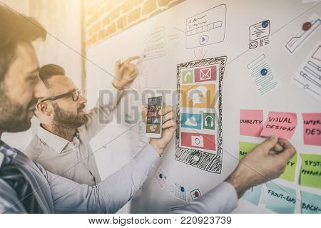 Designers man drawing website ux app development. User experience concept.