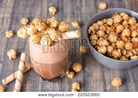 Glasses Of Chocolate Milkshake With Caramel Popcorn.