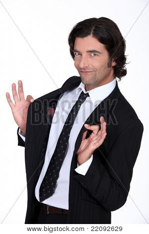 Businessman holding jacket open