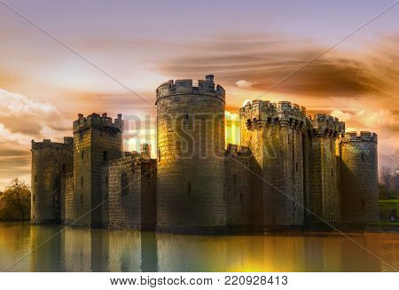 Bodiam Castle 14th-century moated fortification at sunset. England