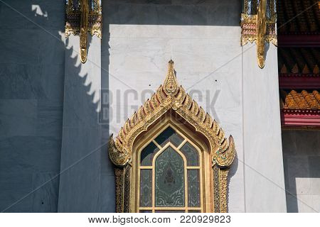 BANGKOK , THAILAND - DECEMBER 19, 2017 : Light and shadow on window at Wat Benchamabophit, One of Bangkok's most beautiful temples is also known as