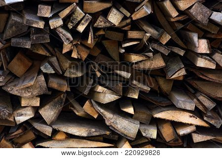 chopped firewood background. conceptual ecology fuel imagery