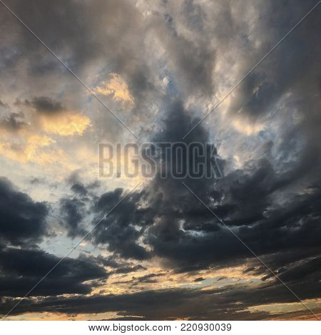beautiful storm sky with clouds background. Dark sky with clouds weather nature cloud storm. Dark sky with clouds and sun