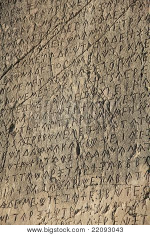 writing on the stone wall of the ancient city of Turkey Patara