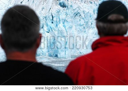 Group of tourists watching glacier from the cruise ship