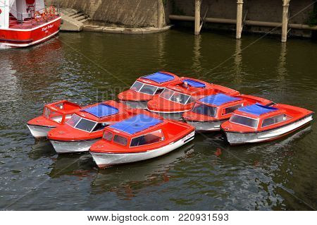 York, Yorkshire, England, UK - May 22, 2016 : Tourist boats on the River Ouse in York