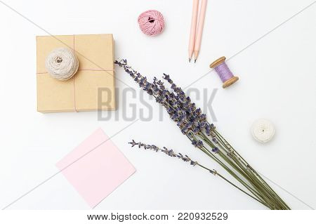 Gift Wrap. Threads, gift box and bouquet of lavender on a white background