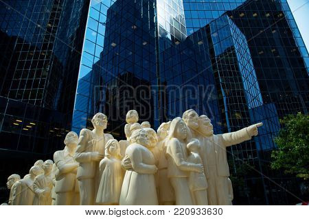 MONTREAL, CANADA - SEPTEMBER 14, 2017:  The Illuminated Crowd created by Raymond Mason is a sculpture of 65 people of all ages, race, facial expressions illustrates the degradation of the human race