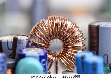 Electromagnetic coil, inductor on circuit board close-up