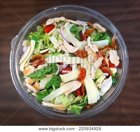 high angle view of fresh salad in glass bowl