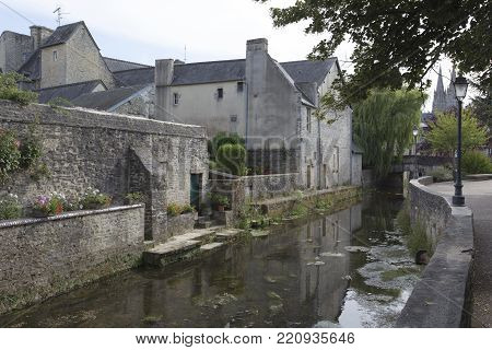 Bayeux, France - August 14, 2016: Aure River in the old city of Bayeux in Calvados department in Normandy, France
