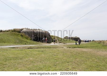 Arromanches, France - August 14, 2016: defence of one of the D-Day beaches of WW2 in Normandy with lot of tourists