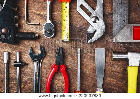 Top View Of Working Tools,wrench,socket Wrench,hammer,screwdriver,plier,electric Drill,tape Measure,
