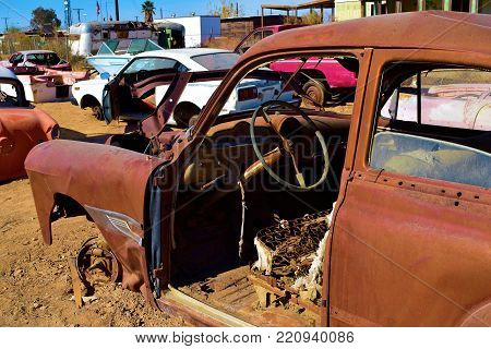 January 2, 2018 in Bombay Beach, CA:  Forgotten landscape including abandoned cars rusting at a junkyard taken in Bombay Beach, CA where people can see how a once popular beach community on the Salton Sea turned into a ghost town caused from drought
