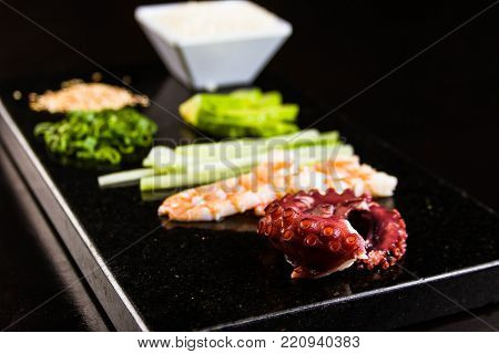 Close up of raw and fresh ingredients and seafood for japanese sushi rolls.