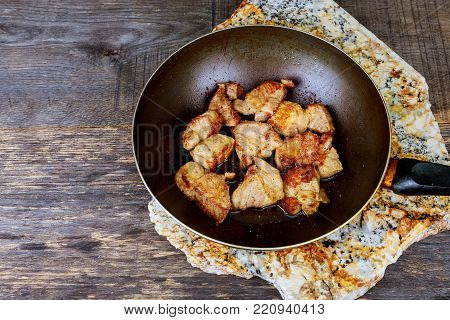 Food cooking in wok Stewed meat in a fryer wok cooked food ready for eat